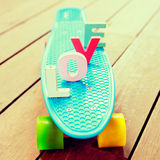 Word love on the blue penny board Royalty Free Stock Photos