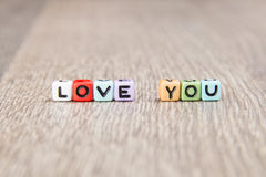 Word love is built of colored cubes Royalty Free Stock Photography