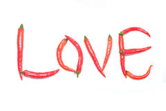 The word love built of red chili peppers on a white Stock Photography