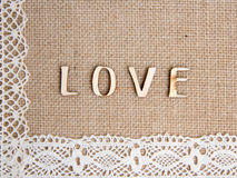 Word love on burlap. And lace Stock Photography