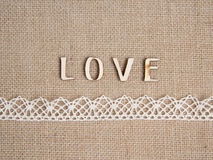 Word love on burlap. And lace Royalty Free Stock Image