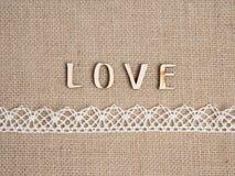 Word love on burlap Royalty Free Stock Image