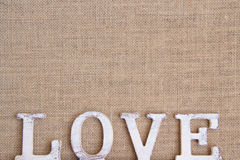 Word love on burlap Royalty Free Stock Photography