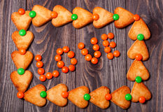 Word love from candies on wooden background Stock Photo