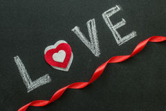 The word love on the chalkboard. Royalty Free Stock Photos