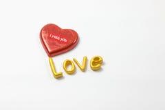 Word love with chocolate. Word love with chocolate on white background Royalty Free Stock Photo
