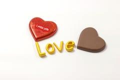 Word love with chocolate. Word love with chocolate on white background Royalty Free Stock Photos