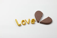 Word love with chocolate. Word love with chocolate on white background Stock Images