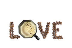 Word LOVE with coffee beans and cup Royalty Free Stock Photography