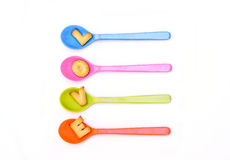 Word  LOVE  in colorful spoons. Royalty Free Stock Photos