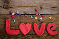 The word LOVE  and  colorfull buttons Royalty Free Stock Photos