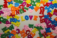 The word LOVE is composed of bright colored letters.  royalty free stock photo