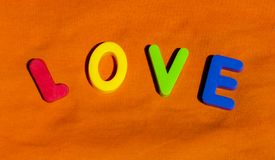 The word Love composed from letters. The word Love composed from colorful children toy big letters on the grass royalty free stock images