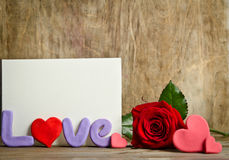 Word Love composition with empty card for text and rose near Royalty Free Stock Photo