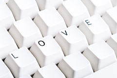 Word LOVE on computer keyboard with empty space on other buttons Stock Photography