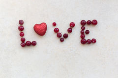 The word love cranberries. On a light background Royalty Free Stock Photo