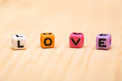 Word love from cubes. On a wooden desk Royalty Free Stock Photography