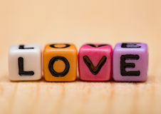 Word love from cubes. On a wooden desk Stock Images