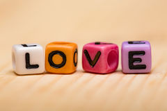 Word love from cubes. On a wooden desk Royalty Free Stock Image