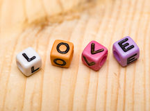 Word love from cubes. On a wooden desk Royalty Free Stock Photo