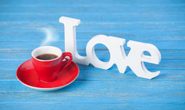 Word love and cup Royalty Free Stock Images