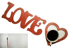 The word love, a Cup of coffee, a heart, a leaf with a pen. stock images