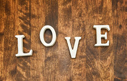 Word LOVE on dark wooden background Stock Images