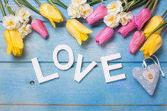 Word love, decorative heart  and  pink, yellow and white flowers Royalty Free Stock Image