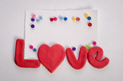 The word LOVE , empty card and colorfull buttons royalty free stock photos