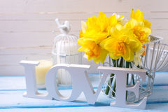 Word love, flowers and candle Stock Image
