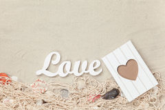 Word Love and frame, net with shells Stock Image