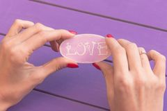 The word love in the hands of a married woman stock images
