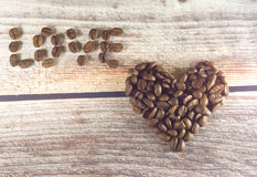 Word love and heart with coffee on wooden background in bw. Coffee word love and heart with coffee on wooden background in bw Royalty Free Stock Photos