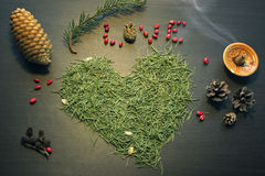Word Love and heart made from tree needles. Word Love and heart made out from pine tree needles and other holiday decorations on a table top view Royalty Free Stock Image