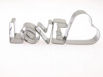Word love and heart from the molds to the dough. Royalty Free Stock Photos