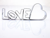 Word love and heart from the molds to the dough. Royalty Free Stock Images