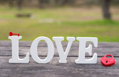 The word love and a heart padlock Royalty Free Stock Images