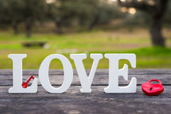 The word love and a heart padlock Stock Images