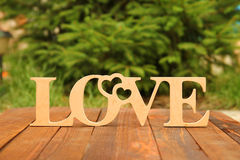 The word love and a heart with roses Stock Photo