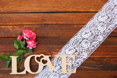 The word love and a heart with roses Royalty Free Stock Photo
