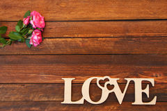 The word love and a heart with roses Stock Image