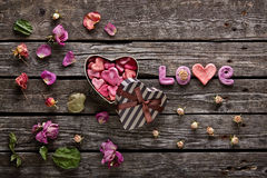 Word Love with heart shaped gift box Royalty Free Stock Photo