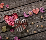 Word Love with Heart Shaped Gift Box Royalty Free Stock Images