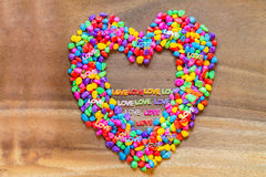 Word Love with Heart shaped Valentines Day  with stones color Royalty Free Stock Photo