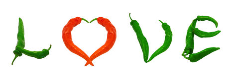 Word Love with heart sign composed of green and red chili pepper Royalty Free Stock Photo