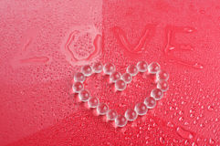 Word love and heart symbol from balls Stock Image