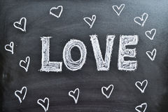 The word Love and hearts on a blackboard Stock Photo