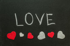 The word love with hearts on the chalkboard Royalty Free Stock Images