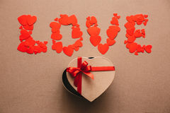 Word Love from hearts and gift box in the shape of a heart. Royalty Free Stock Image