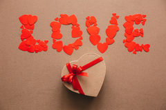 Word Love from hearts and gift box in the shape of a heart. Stock Images